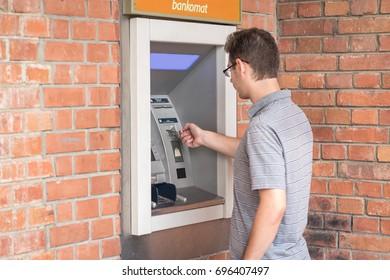 Photo of man using ATM bank machine