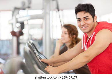 photo of man who is doing workout on a bicycle at the gym
