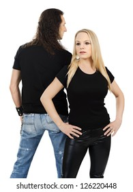 Photo of a man and woman posing with blank black shirts. Male is facing backwards so a custom shirt design can be shown on front and back.
