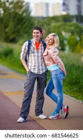 Photo of man with woman walking in park at summer