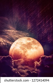 Photo Manipulation. Beautiful colorful skyscape with many stars and meteor shower. Landscape of sky with blood moon behind partial cloudy. Serenity nature background. The moon taken with my camera.