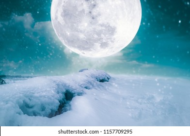 Photo Manipulation. Landscape at snowfall with supermoon. Majestic night with full moon on sky. Snow covered the ground in winter season. Serenity nature background. The moon taken with my camera.