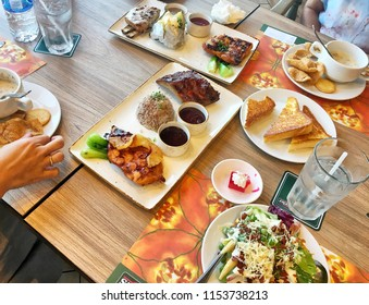 Photo of Many kinds of food on the table in Sizzler restaurant in Thailand Bangkok, Thailand July 1, 2018