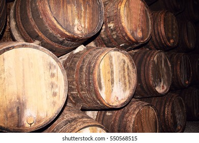 photo of Many old wood barrels on a wine factory