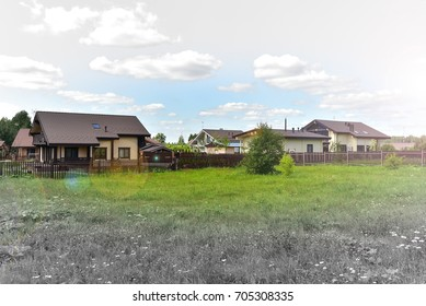 Photo of many wooden houses on blue sky background.