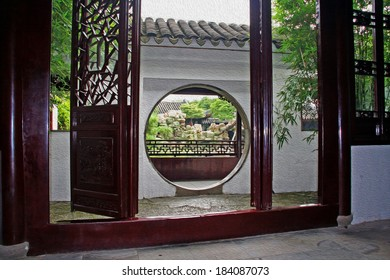 Photo of master of nets garden seen through moon gate, Suzhou, China, stylized and filtered to resemble an oil painting.