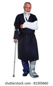 Photo of a mature male with various injuries on a crutch, he's wearing a neck brace, arm sling and leg cast and has a black eye, isolated on a white background.
