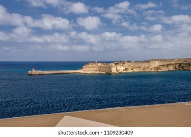 Photo of Mediterranean Sea, view from Valletta, Malta. Blue cloudy sky as background.