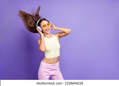 Photo of meloman lady with her cool casual outfit in trendy spectacles headset she isolated on shine violet purple background listen beat mp3 track playlist