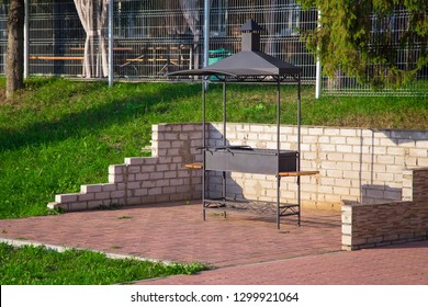 Photo of metal grill in the sunny summer day