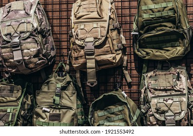 Photo of military store with different soldier and tactical backpacks stand.