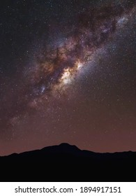 Photo of the Milky Way galaxy above the silhouette of Mount Tampomas