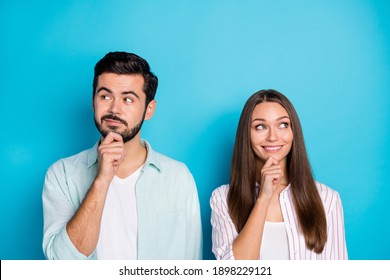 Photo of minded married couple hand chin look empty space think happy life isolated on blue color background