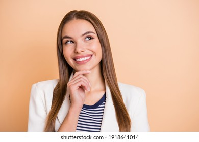 Photo of minded thoughtful lady finger chin look up empty space wear white blazer isolated pastel beige color background