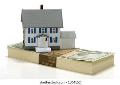 Photo of a Miniature House on Top of Money - Real Estate Concept