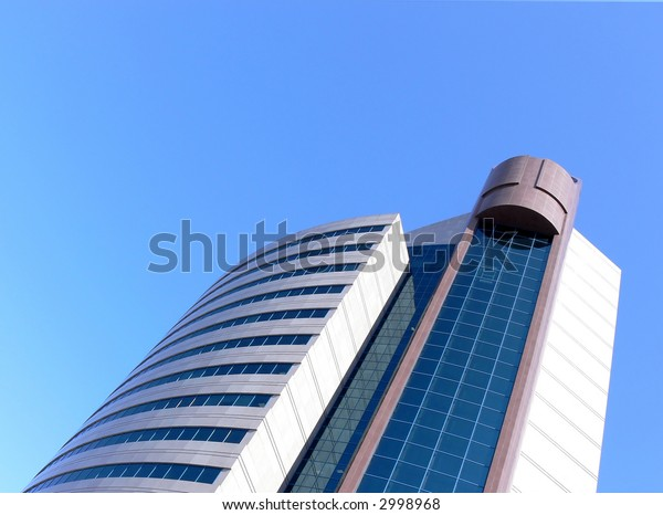 Photo of a modern building of large bank on a background of the cloudless sky