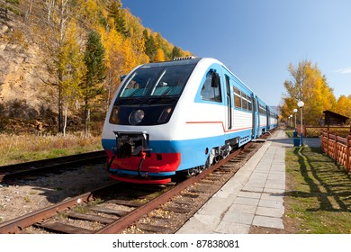 photo of modern diesel train on vintage railroad near Lake Baikal