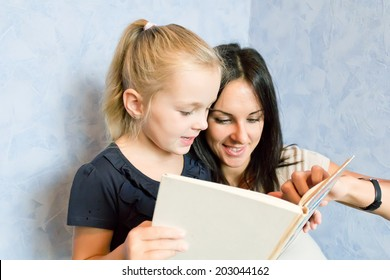 Photo of mother and daughter is younger schoolgirl