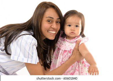 photo of a Mother holding her daughter .