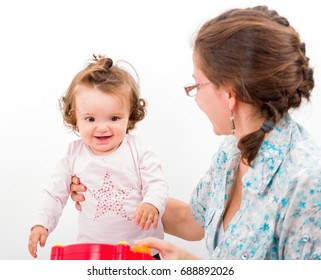Photo of mother playing with her daughter