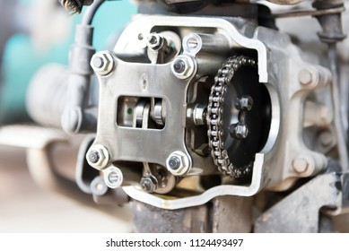 Photo of motorcycle engine, motor, in garage, close-up