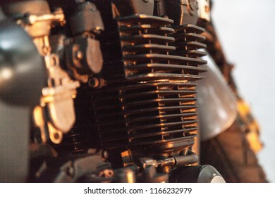 A photo of a motorcycle part close-up. Carburetor.