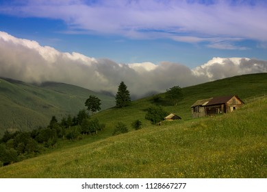 Photo of mountain village in the summer under beautiful cloudy sky. Ukraine, Carpathians, Dzembronia