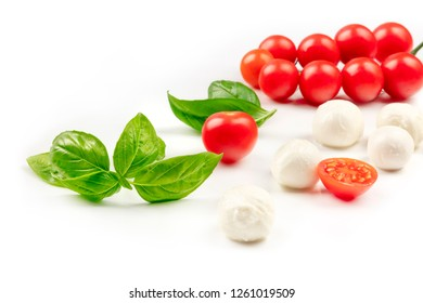 A photo of Mozzarella cheese balls with fresh basil leaves and cherry tomatoes, the ingredients of the Italian Caprese salad, on a white background with a place for text