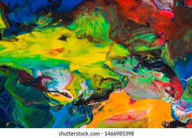 Photo of multicolor plasticine mixed texture. Multicolored abstract piece of mix plasticine.