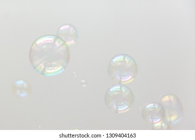 Photo of multi-colored soap bubbles, creative background, selective focus