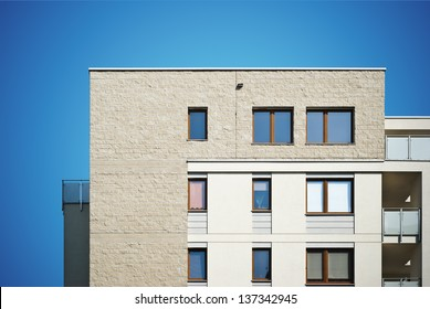 Photo of a new modern residential building with balconies.