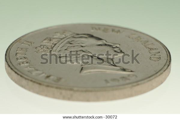 A photo of a New Zealand twenty-cent coin