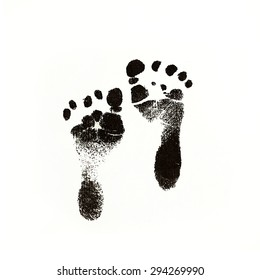 a photo of newborn baby footprints made with black in on white square paper