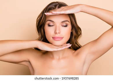 Photo of nice long hairdo optimistic lady without clothes hand face closed eyes isolated on pastel beige color background