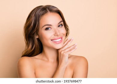 Photo of nice long hairdo optimistic lady without clothes hand face isolated on pastel beige color background