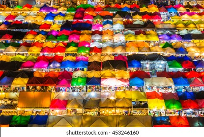 photo of night market high view from building colorful tent retail shop and lighting at Rachada rain market Thailand