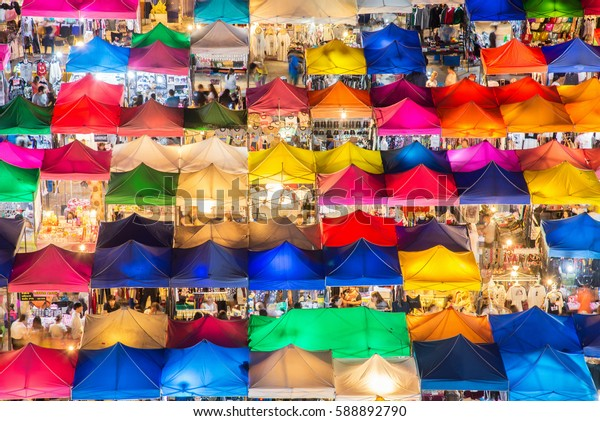 photo of night market high view from building colorful tent retail shop and lighting