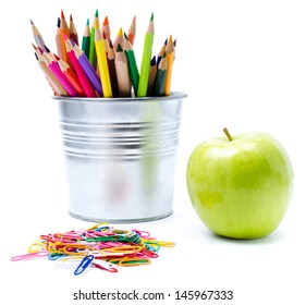 Photo of office and student gear with Color pencils in aluminum pencil  holders, Back to school supplies