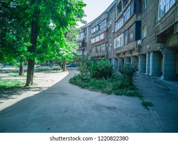 Photo of an old brick multi-storey apartment house in a poorly-developed. Zaporozhye, Ukraine, 24 August 2018.