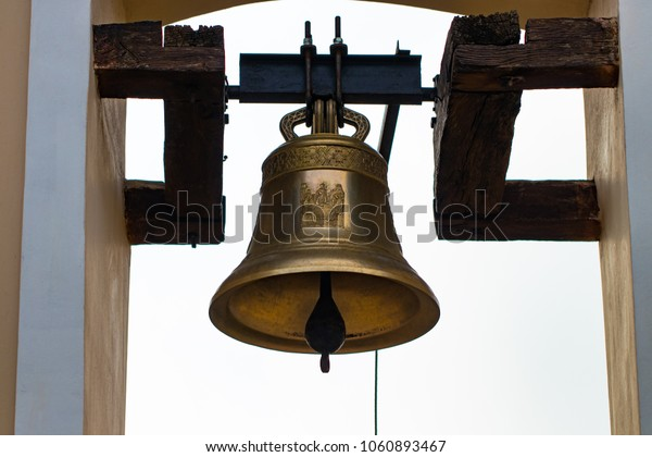 The photo of old Catholic copper church bells.