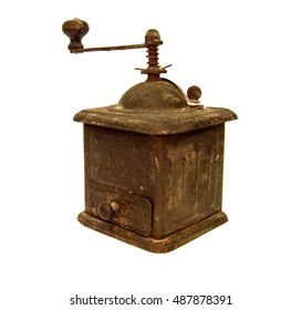 Photo of an old coffee grinder isolated on a white background.