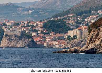 Photo of old harbour and fortified old town in Dubrovnik, Dalmatia, Croatia. View from Lokrum Island.