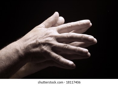 photo of an old male hands on black
