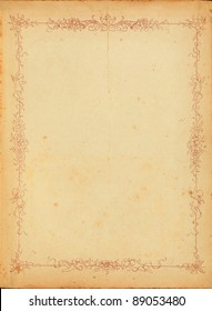 Photo of old stained yellowed paper from the 1920s with a floral border design.