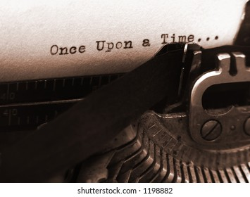 A photo of an old type writer with focus on the text