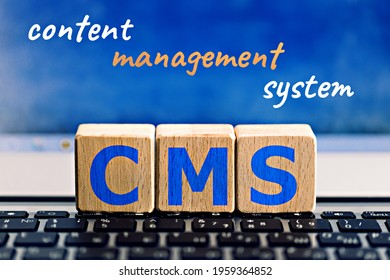photo on CMS (content management system) theme. wooden cubes with the abbreviation