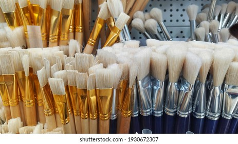Photo on the phone. Paint brushes on a shop counter. Artist's tool. paint brushes.
