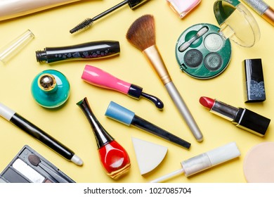 Photo on top of different cosmetics on yellow background