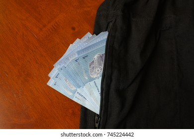 Photo for one ringgit Malaysia in natural light in the pocket of the pants