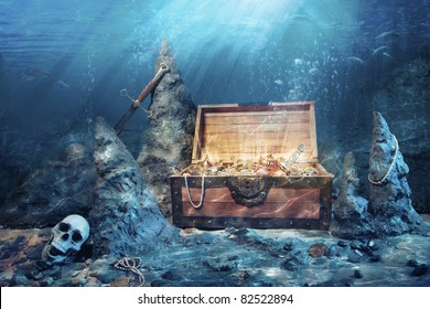 photo of open treasure chest with shinny gold underwater